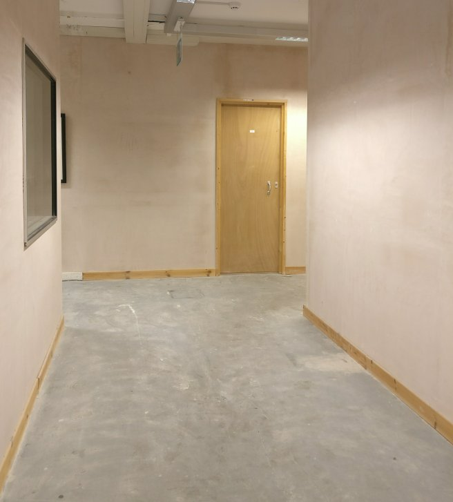 Picture of corridor with door at end
